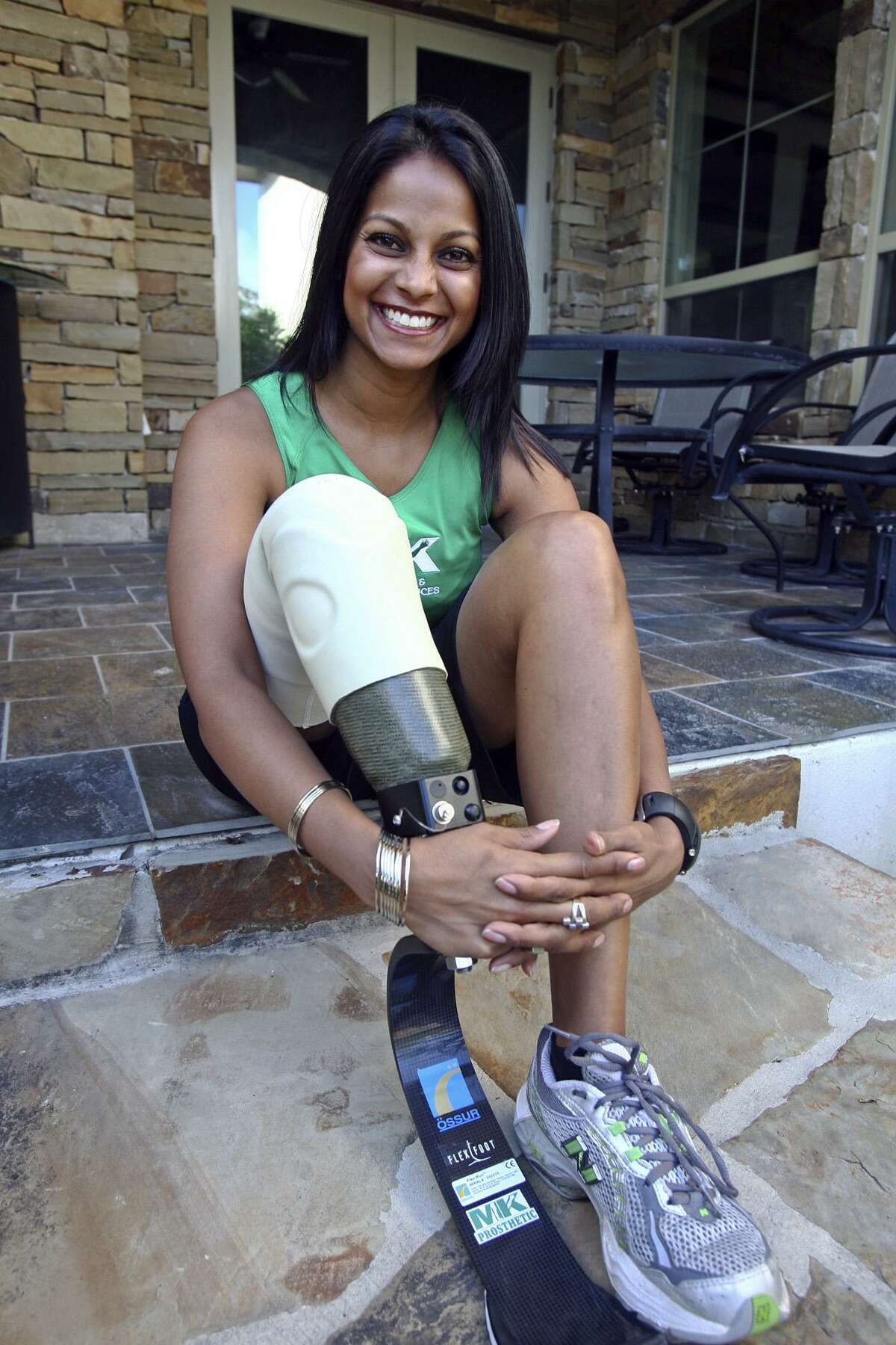 Mona Patel, whose right leg was amputated below the knee, is seen training for a half-marathon.