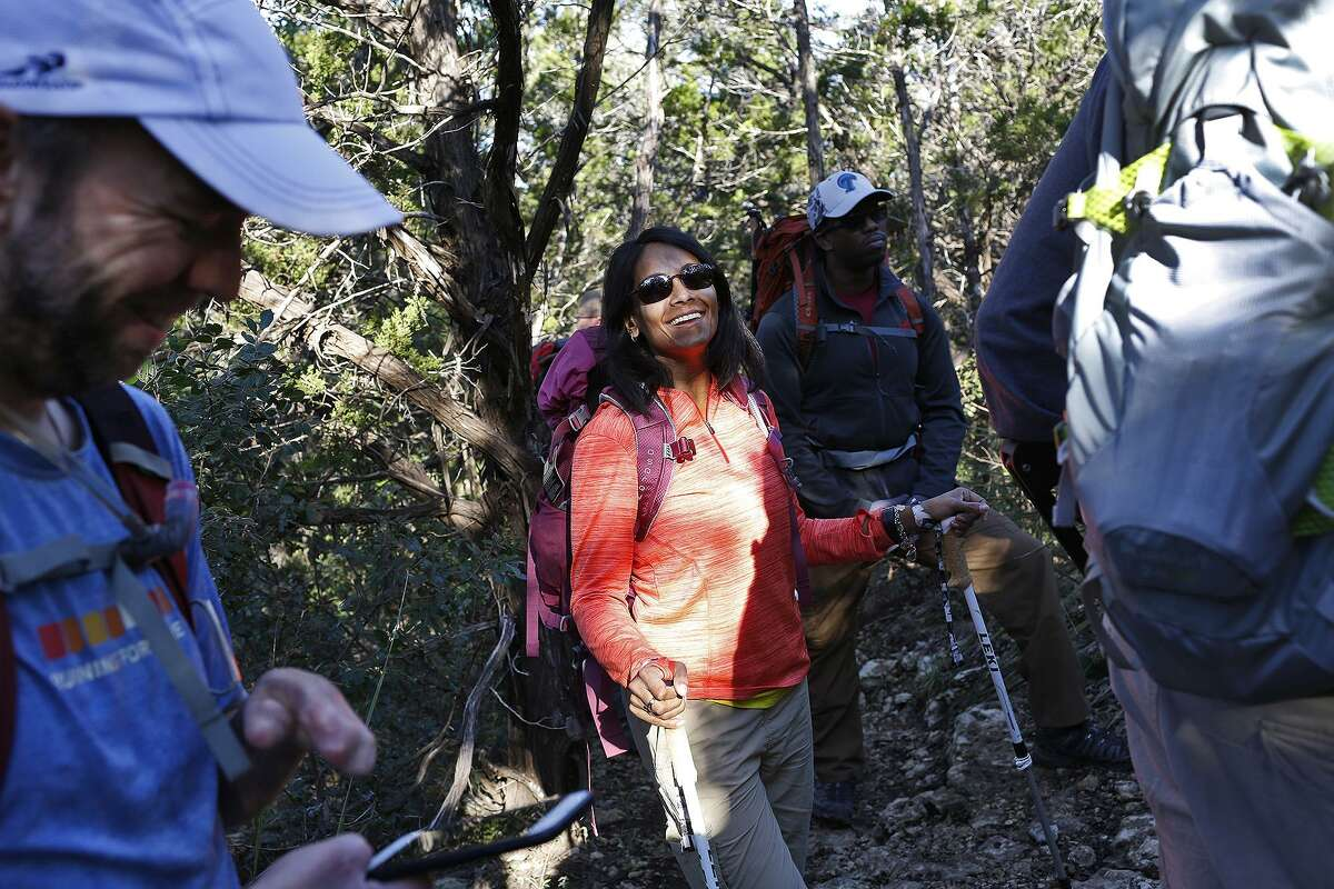 Mona Patel, a below-knee amputee, also climbed Mt. Kilimanjaro in 2016. Here, she takes a break with fellow climbers Ian Warshak, a quadruple amputee (left) and Dr. Karwin McCain, a physical medicine and rehabilitation doctor, as they trained during a hike at Friedrich Wilderness Park in San Antonio.