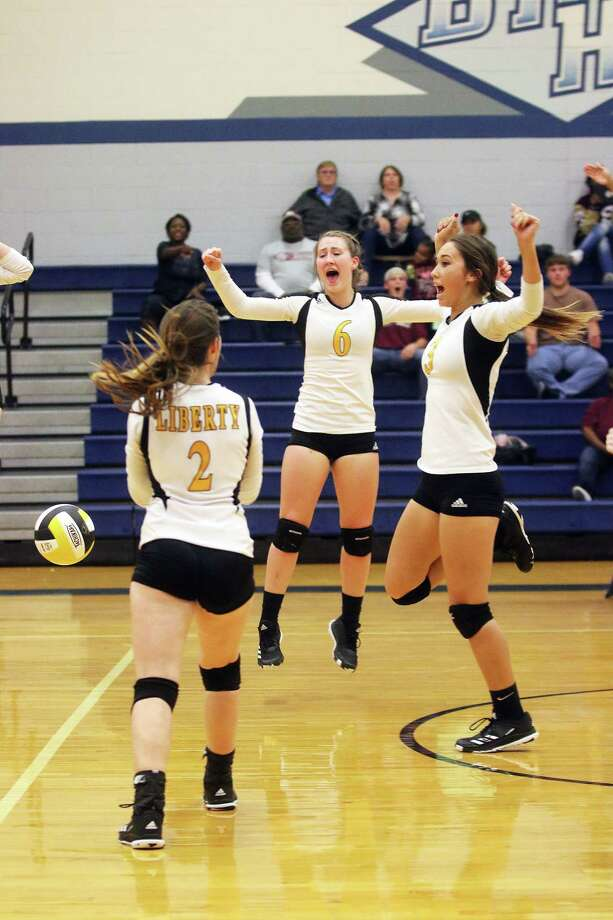 Lady Panthers Kaci West, Kara Cannon, and Harley Davis celebrate after Liberty wins the first game in a come-back, 30-28. Photo: David Taylor
