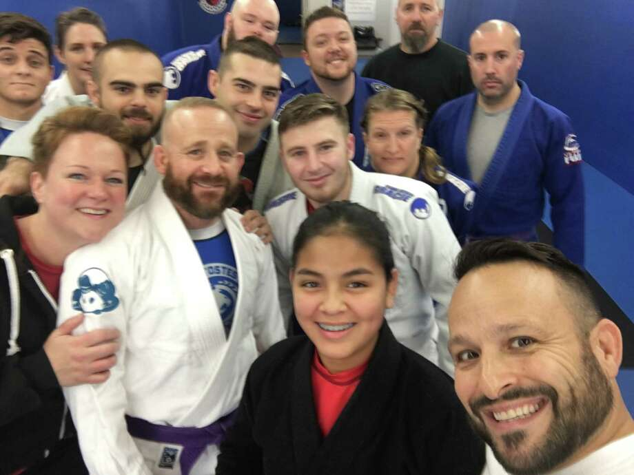 Roll-A-Thon participants get ready to spend 24 hours jiu jitsu fighting,and training, no sleep, no meals in last year's fundraiser for Make-A-Wish. They are allowed to shower and change clothes every four hours. Roll-A-Thon founder and Halfmoon town planner Rich Harris is in the lower right hand corner. Photo: Lynda J. Edwards