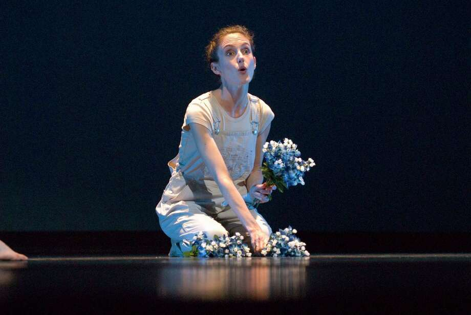 """Karen Stokes performs a scene from the 2003 debut of her Houston-centric dance, """"Hometown."""" Photo: Buddy Steves"""