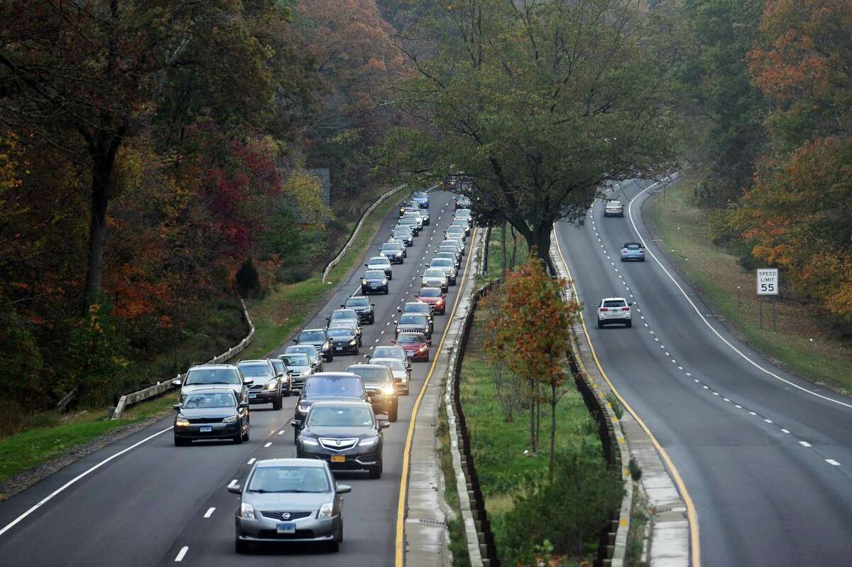 Traffic moves slowly in the southbound lanes of the Merritt Parkway, towards, Greenwich, following a fatal accident involving a tractor trailer and car in Stamford, Conn. on Thursday, Nov. 2, 2017.