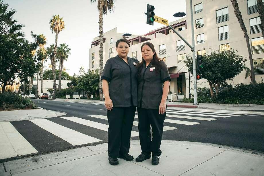 Blanca Guerrero (left) and Aurelia Gonzalez are housekeepers at the JW Marriott Santa Monica Le Merigot Hotel, where they make $15.66 an hour. Photo: Carlos Gonzalez, NYT