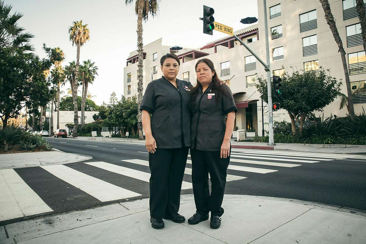 Blanca Guerrero, left, and Aurelia Gonzalez, both housekeepers at the JW Marriott Santa Monica Le Merigot Hotel, where they make $15.66 an hour, in Santa Monica, Calif., Sept. 19, 2017. Fewer than a third of hotel guests leave any money for housekeepers. (Carlos Gonzale/The New York Times)