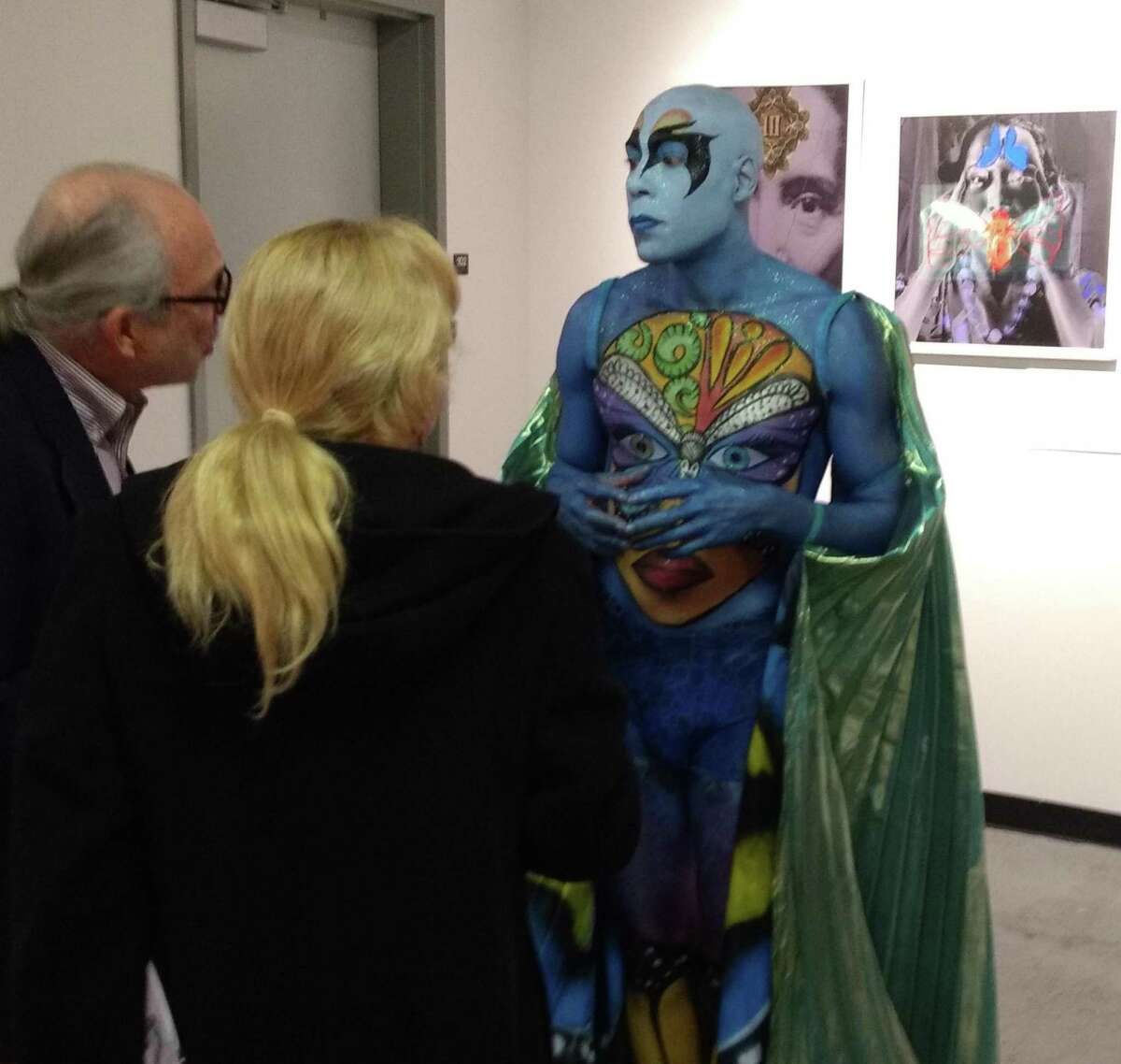 An artist-butterfly chats with guests at the 2016 kick-off party for the Bridgeport Art Trail.