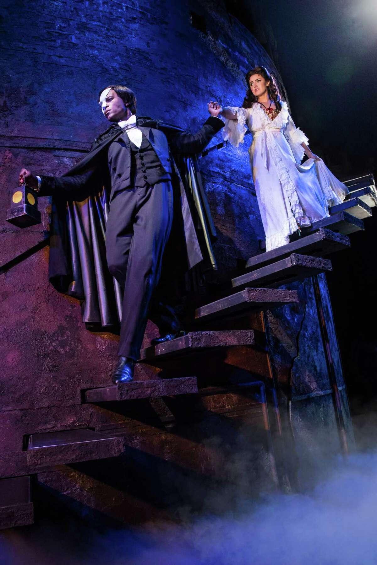 Derrick Davis as The Phantom and Eva Tavares as Christine Daae.