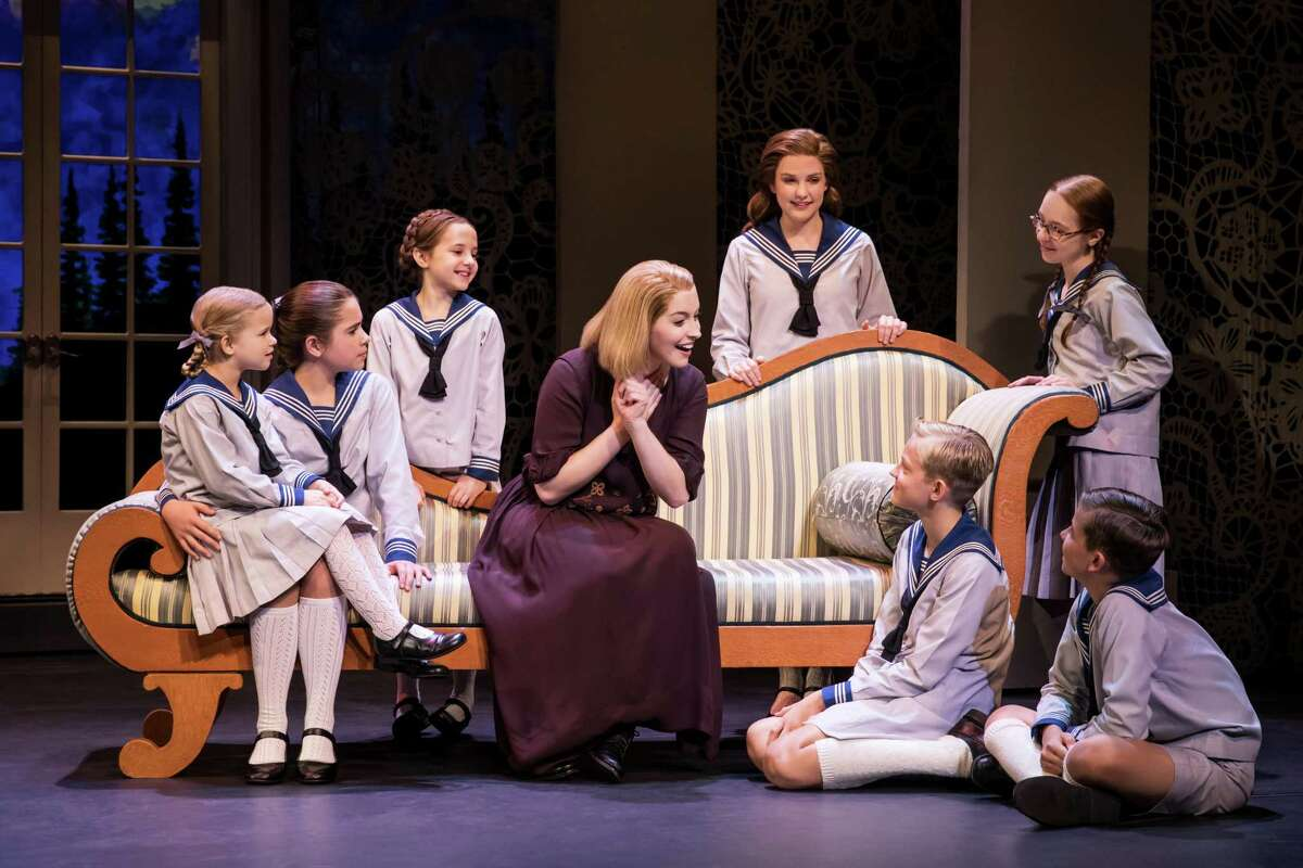 Jill-Christine Wiley as Maria Rainer with the von Trapp children in a scene from