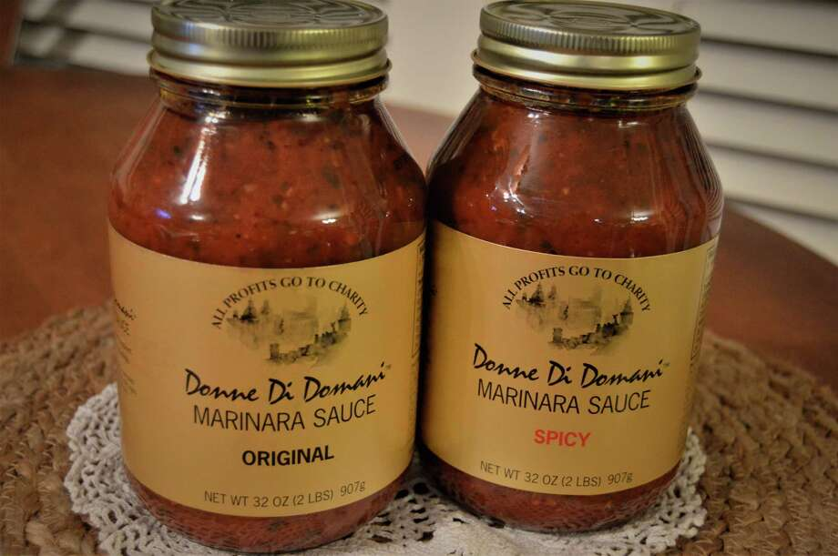 Donne Di Domani, a group of Italian-American women who promote awareness of Italian heritage,  sells its famous spaghetti sauce at the Nutcracker Market. Photo: Donne Di Domani