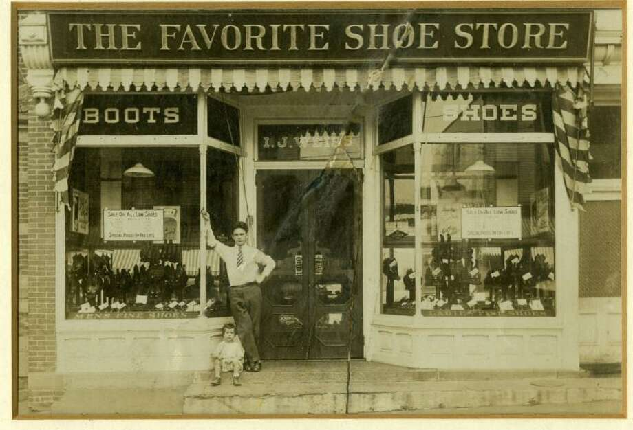 "The Greenwich Historical Society honors the town's Jewish community in its new exhibition, ""An American Odyssey: The Jewish Experience in Greenwich."" Historical objects, such as this photo of the Favorite Shoe Store that opened at 92 Greenwich Ave. in 1914, help tell the story. Photo: Greenwich Historical Society / Contributed Photo / Connecticut Post contributed"