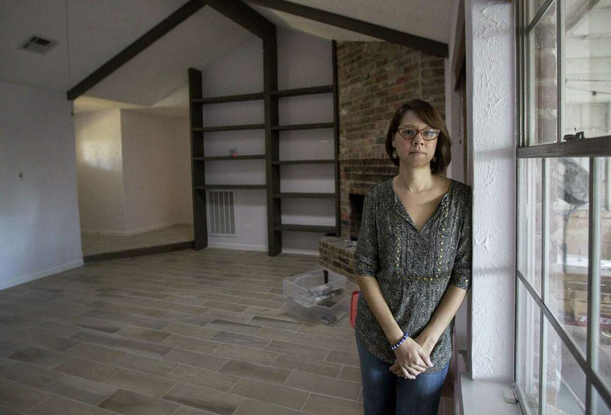 A woman poses in her Houston house that was flooded during Hurricane Harvey. Colorado-based Startek Inc. is hiring for 400 temporary bilingual customer service positions in San Antonio to assist with families affected by U.S. hurricanes.