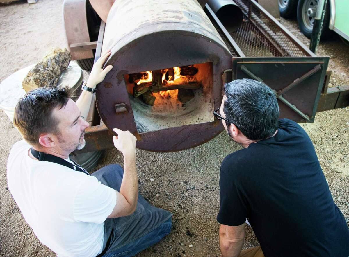 Uchi's Tyson Cole, left, and Franklin Barbecue pitmaster/owner Aaron Franklin are teaming up to open Loro restaurant in Austin, a merger of Japanese cuisine and barbecue.