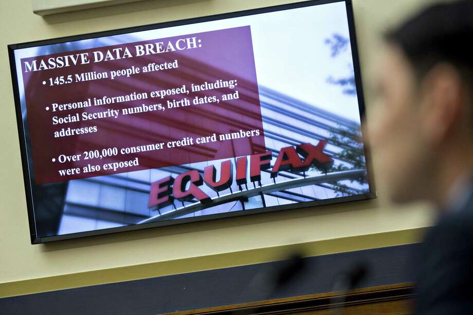 "An Equifax Inc. slide is displayed on a monitor during a House Financial Services Committee hearing in Washington on Oct. 25. Texas Attorney General Ken Paxton said Friday his office has served Equifax Inc. an investigative subpoena known as a civil investigative demand, continuing his ""formal investigation"" of the company's massive data breach impacting as many as 145.5 million Americans. Photo: Andrew Harrer /Bloomberg News / © 2017 Bloomberg Finance LP"