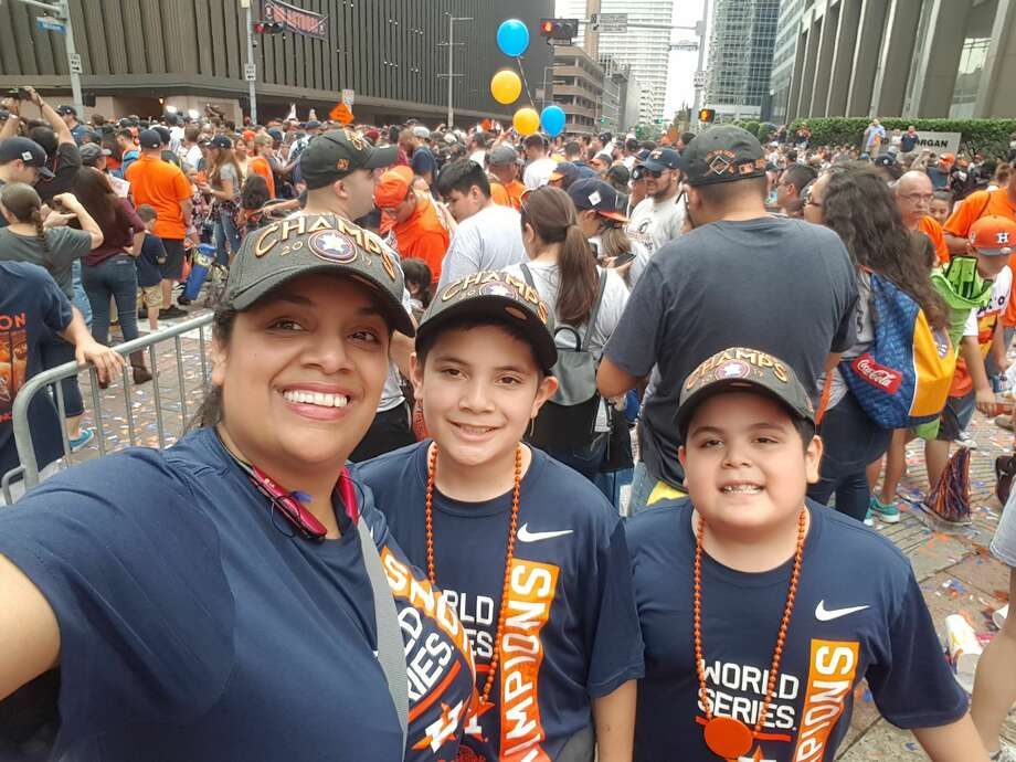 Houston Astros fans begin to line the city streets in preparation for the World Series victory parade Tuesday afternoon. Photo: Deborah Garza
