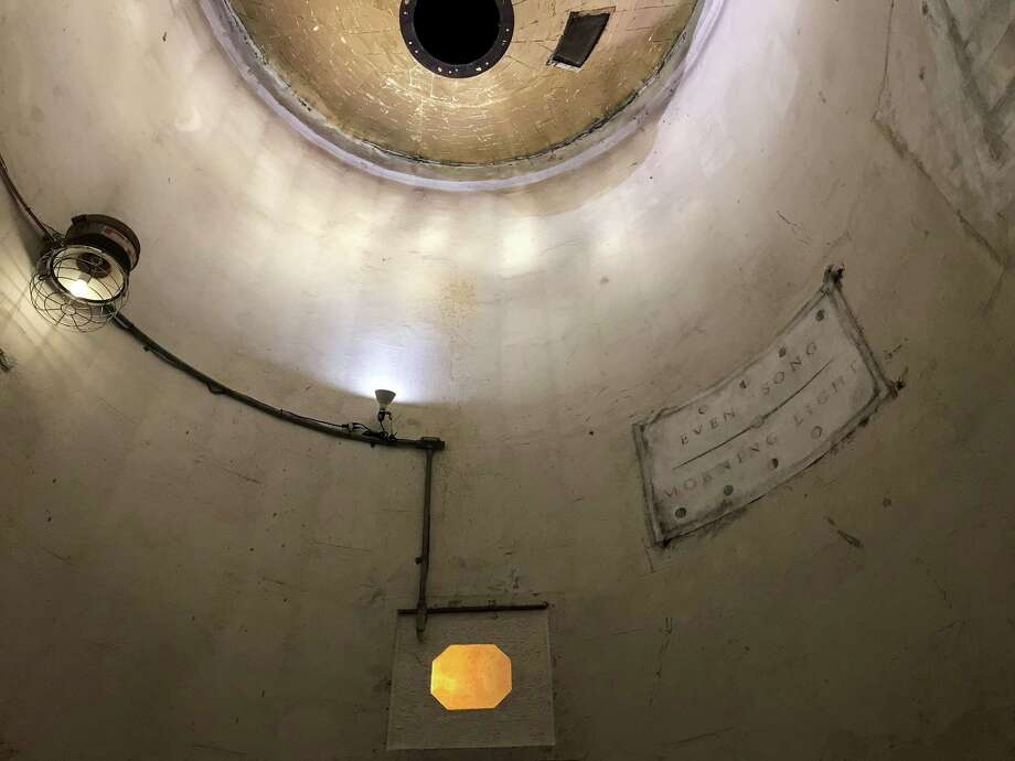 Jill Bedgood transformed a silo at SITE Gallery into a meditative space inspired by a Byzantine chapel, plastering the ceiling funnel with gold-leaf squares and drawing lightly on the walls. Photo: Molly Glentzer