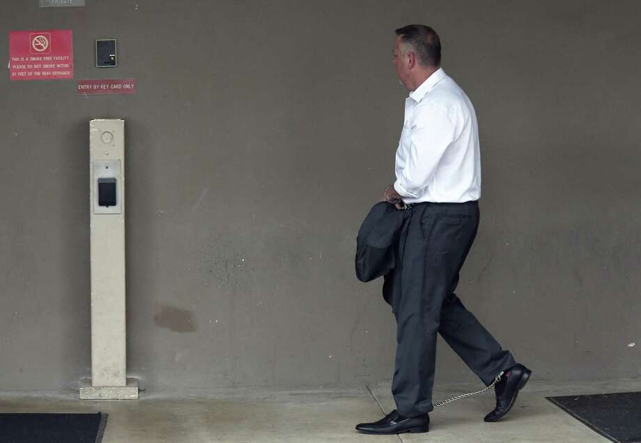 A handcuffed Stan Bates makes his way into the San Antonio federal courthouse on May 17 following his arrest. He and state Sen. Carlos Uresti are accused of defrauding investors with FourWinds Logistics, a now-defunct frac-sand company. Bates was FourWinds CEO and Uresti served as outside legal counsel for a short time. Photo: Jerry Lara /San Antonio Express-News / 2017 San Antonio Express-News