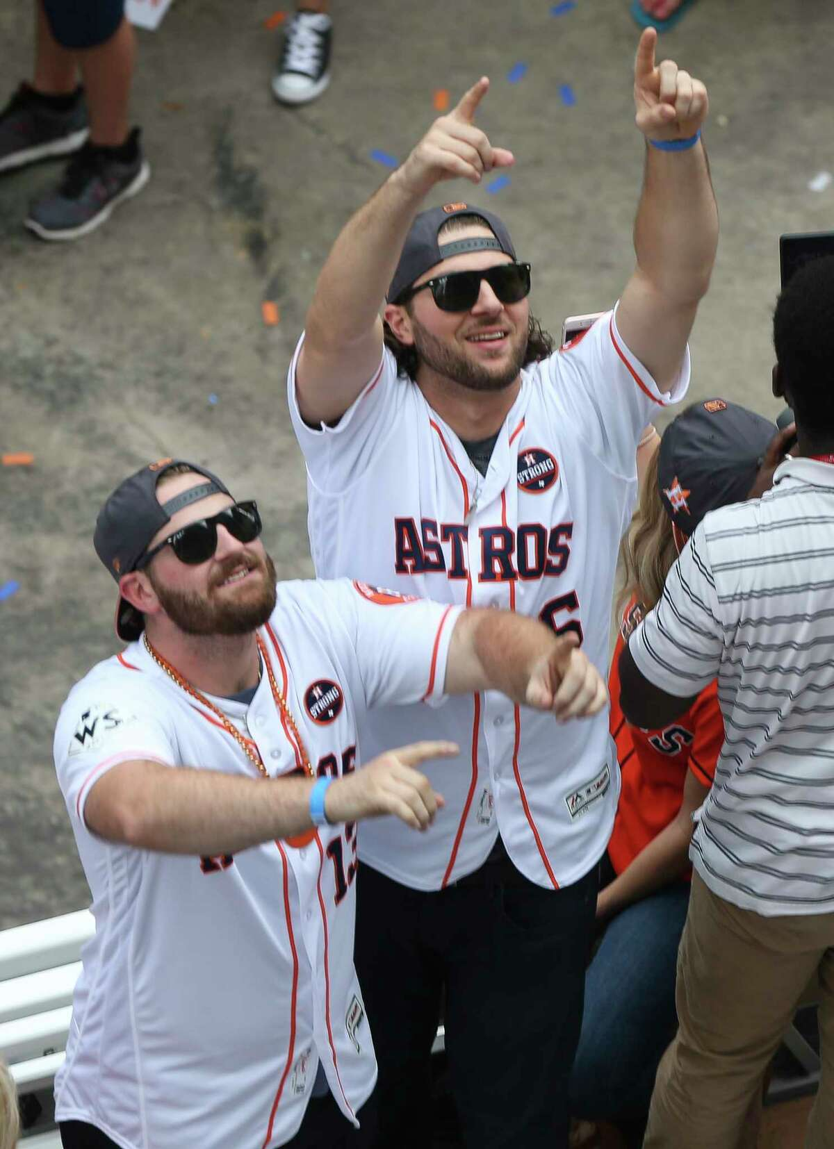 Houston Astros players Tyler White, left, and Jake Marisnick cheer the crowd during World Series Parade at the intersection of Milan and Polk Streets Friday, Nov. 3, 2017, in Houston.