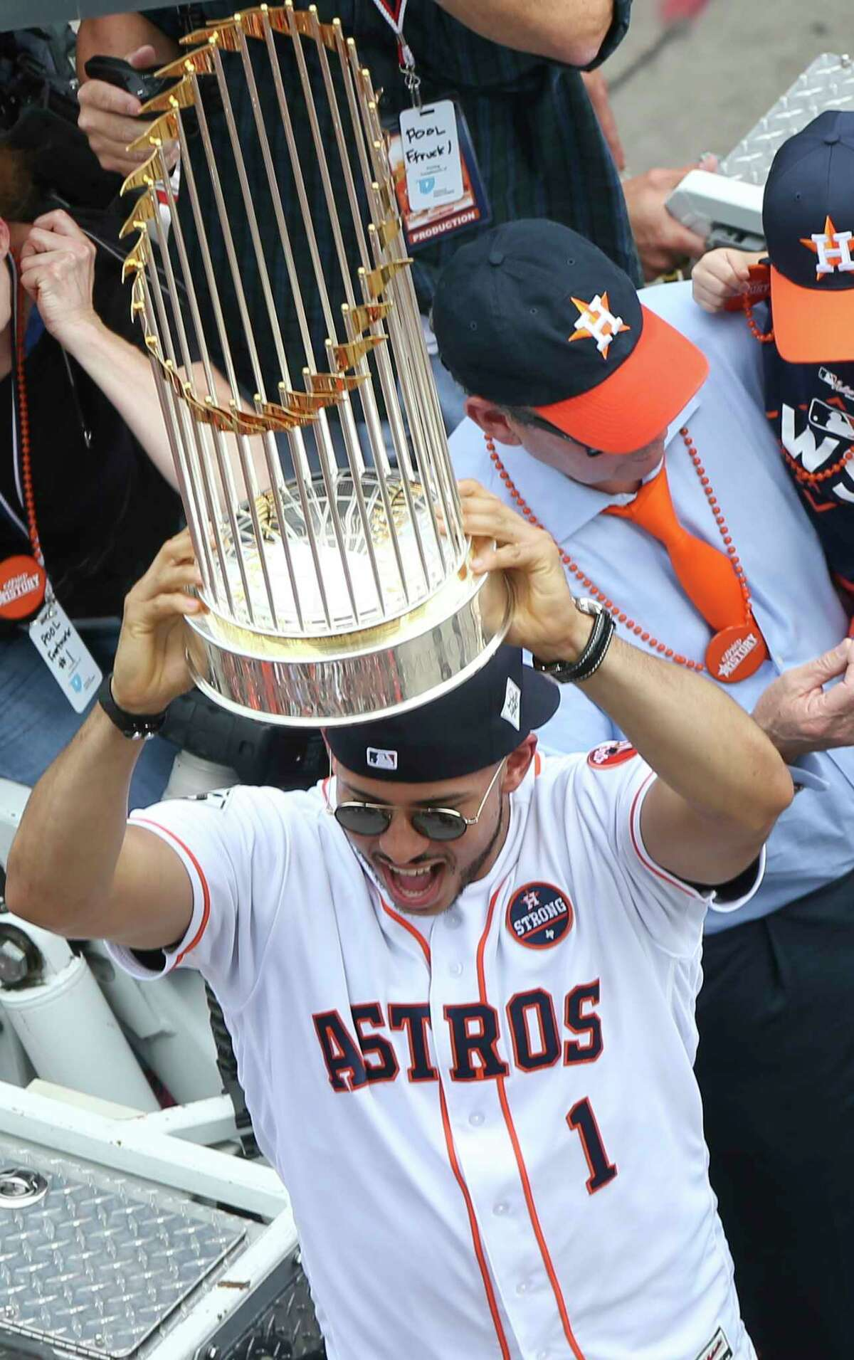 Houston Astros player Carlos Correa cheers the crowd with the World Series trophy during the Astros World Series Parade at the intersection of Milan and Polk Streets Friday, Nov. 3, 2017, in Houston.