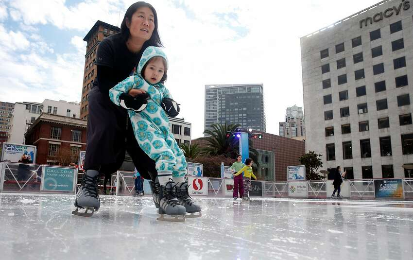 Rose Nieh provides support for Amelie, 3, while spinning around the holiday ice skating rink at Union Square in San Francisco, Calif. on Friday, Nov. 3, 2017.