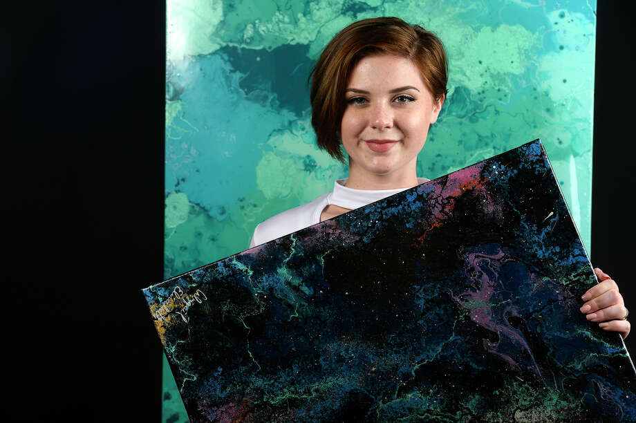 Abigail Turner poses with some of her abstract paintings.  Photo taken Thursday 11/2/17 Ryan Pelham/The Enterprise Photo: Ryan Pelham / ©2017 The Beaumont Enterprise/Ryan Pelham
