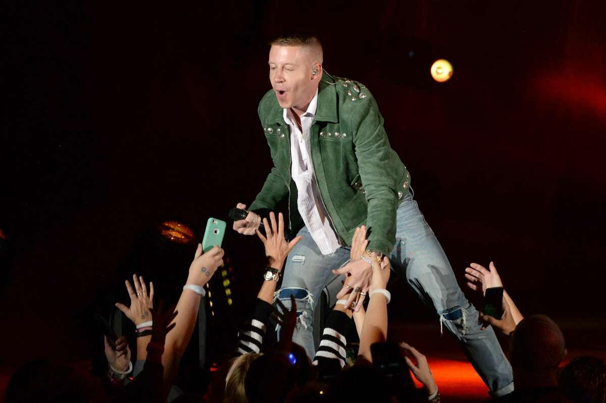 Macklemore joins the former Seahawk in distributing the book to social studies and language arts teachers in Seattle middle and high schools.