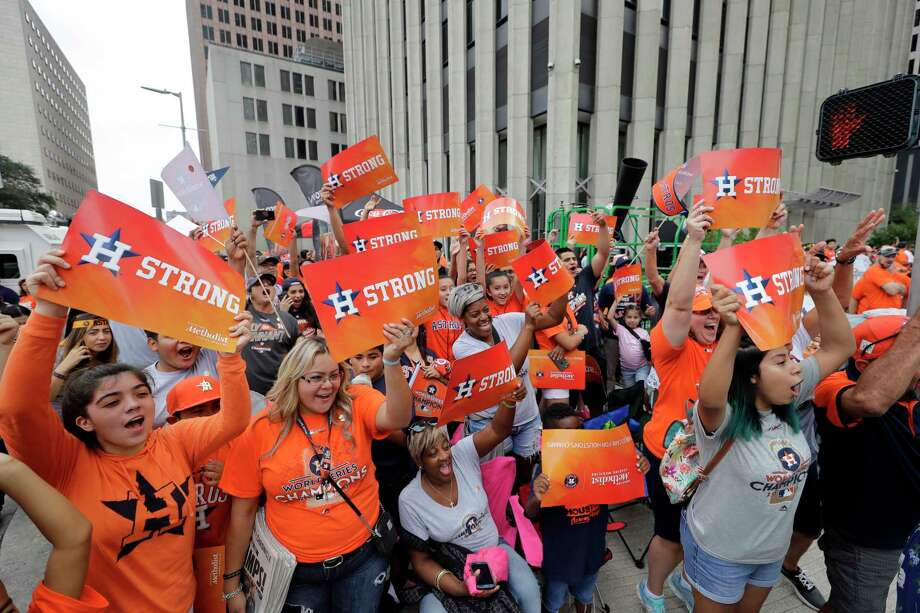 Houston Astros fans celebrate before a parade honoring the World Series baseball champions, Friday, Nov. 3, 2017, in Houston. (AP Photo/David J. Phillip) Photo: David J. Phillip, STF / Copyright 2017 The Associated Press. All rights reserved.