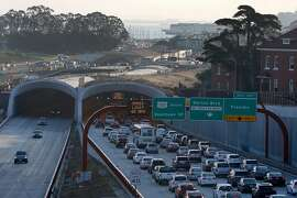 Commuters drive below construction work continuing on the Presidio Tunnel Tops landscaping project in San Francisco, Calif. on Wednesday, Nov. 1, 2017. When completed, the landscaping will completely cover the Presidio Parkway tunnels and bridge the gap between the main post and Crissy Field.