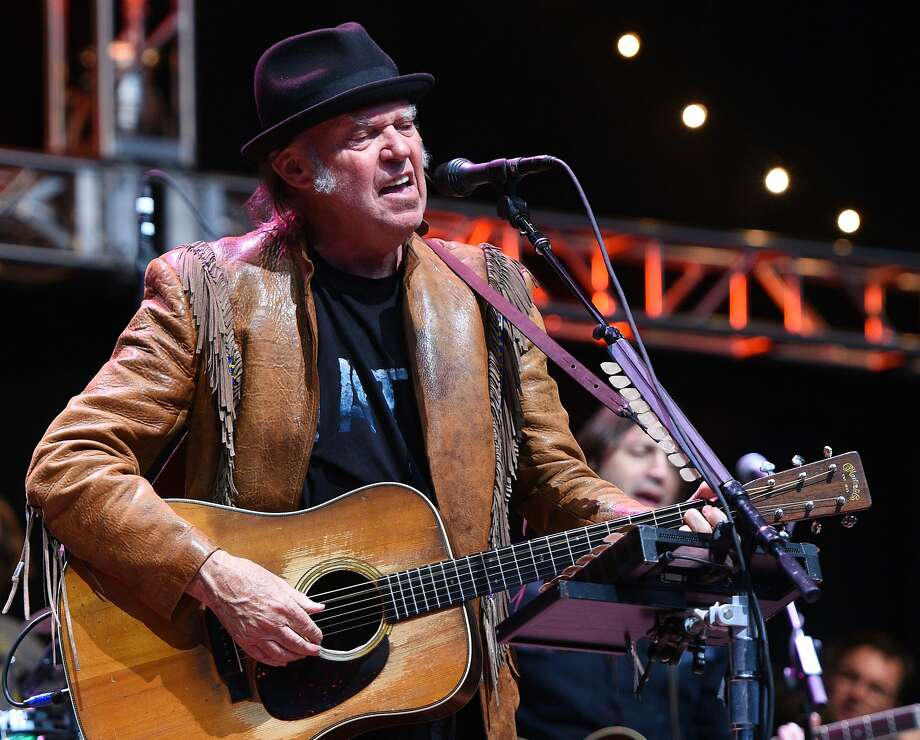 Neil Young is auctioning off collectibles that he has gathered over many years in part to benefit the Bridge School, which he and his then-wife founded in Hillsborough to help children with severe speech and physical impairments. The items for sale include a 1965 Gibson ES-345 left-handed electric guitar. Photo: C Flanigan, FilmMagic
