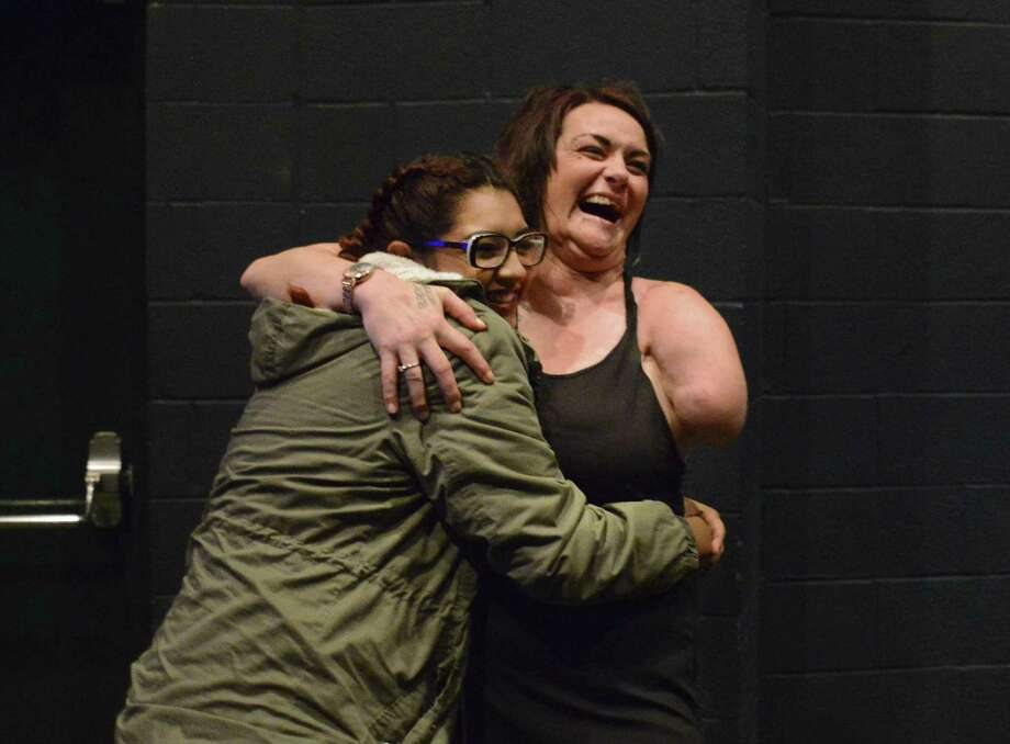 McCollum High School senior Kayla Vargas embraces Sarah Panzau Evans, whose injuries in her 2003 crash included a severed arm and fractured jaw. Photo: Billy Calzada / San Antonio Express-News