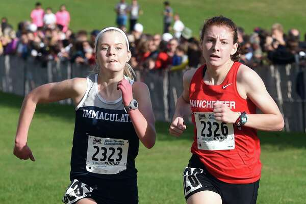 Kate Hedlund (right) of Manchester and Angela Saidman of Immaculate near the finish line placing fourth and fifth respectively in the 2017 CIAC Fall Championship Girls Cross Country race in Manchester on November 3, 2017.