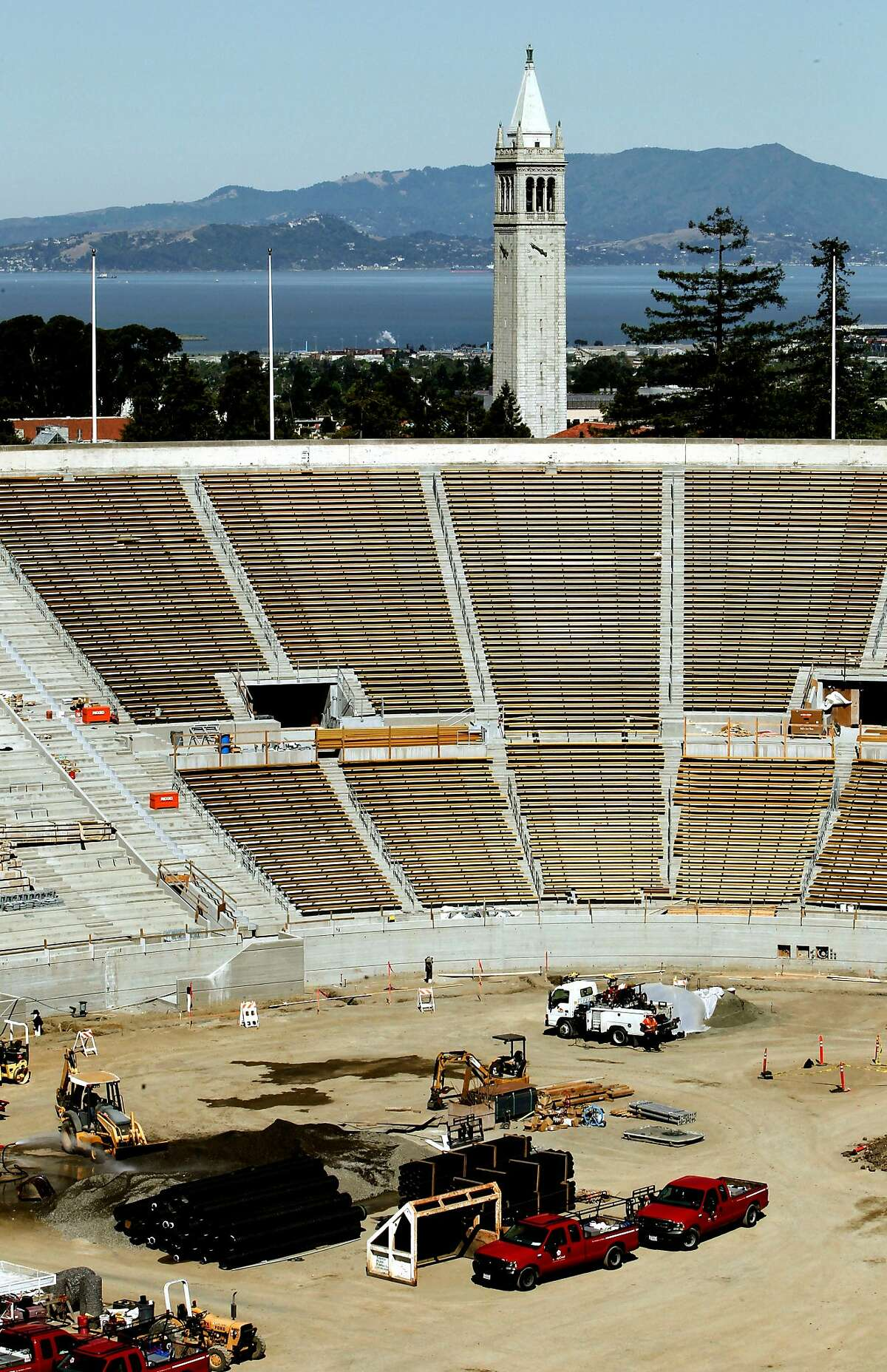 Construction crews were putting the finishing touches on the seismic retrofitting and renova tion of UC Berkeley's Memorial Stadium in 2012. The stadium today carries a $314 million debt.