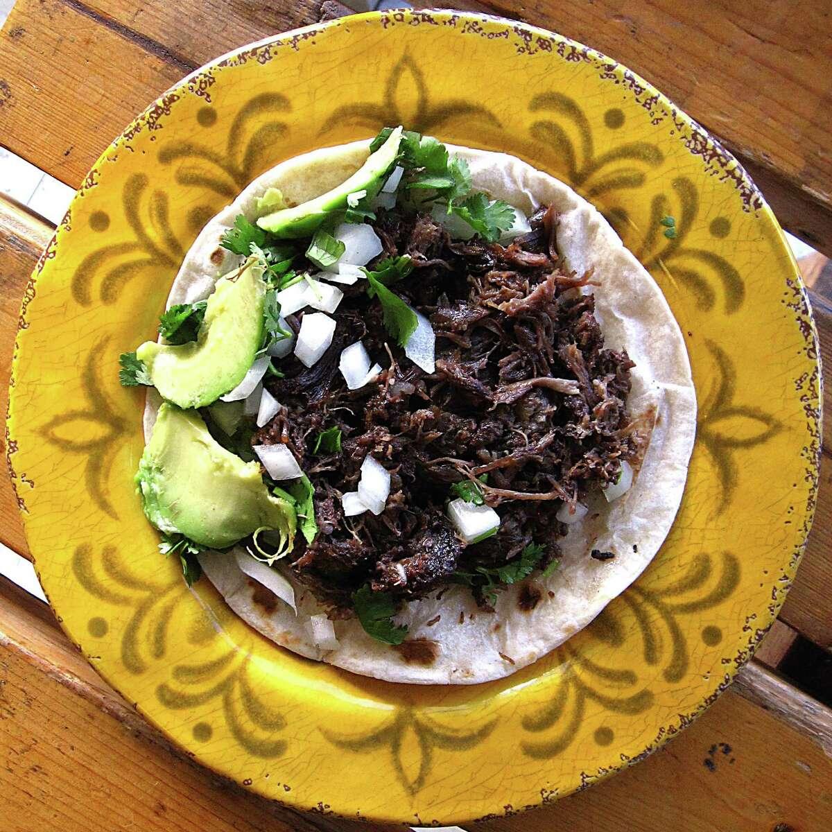 Barbacoa taco with onions, cilantro and avocado from Mimi's Barbacoa.
