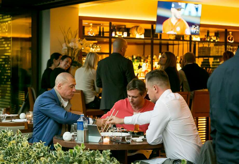 People dine on the patio at Nobu, at the Epiphany Hotel in Palo Alto. Photo: John Storey, Special To The Chronicle