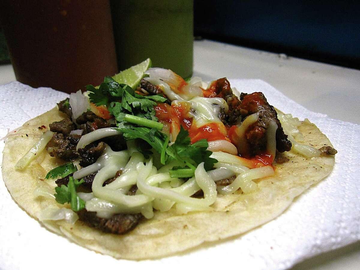 Carne asada taco on a flour tortilla with onions, cilantro and cheese from the Tacos de Güero truck.