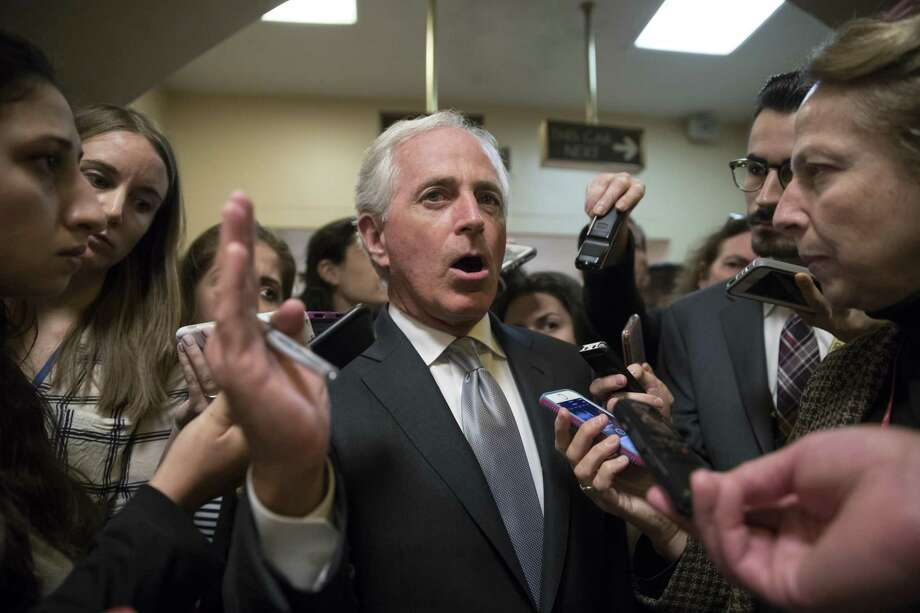 """Speaking to reporters on Capitol Hill, Sen. Bob Corker criticizes President Donald Trump for """"debasing"""" the country. A reader praises Corker and other officials — including Texas House Speaker Joe Straus — for speaking truth to power. Photo: J. Scott Applewhite /Associated Press / The Associated Press"""