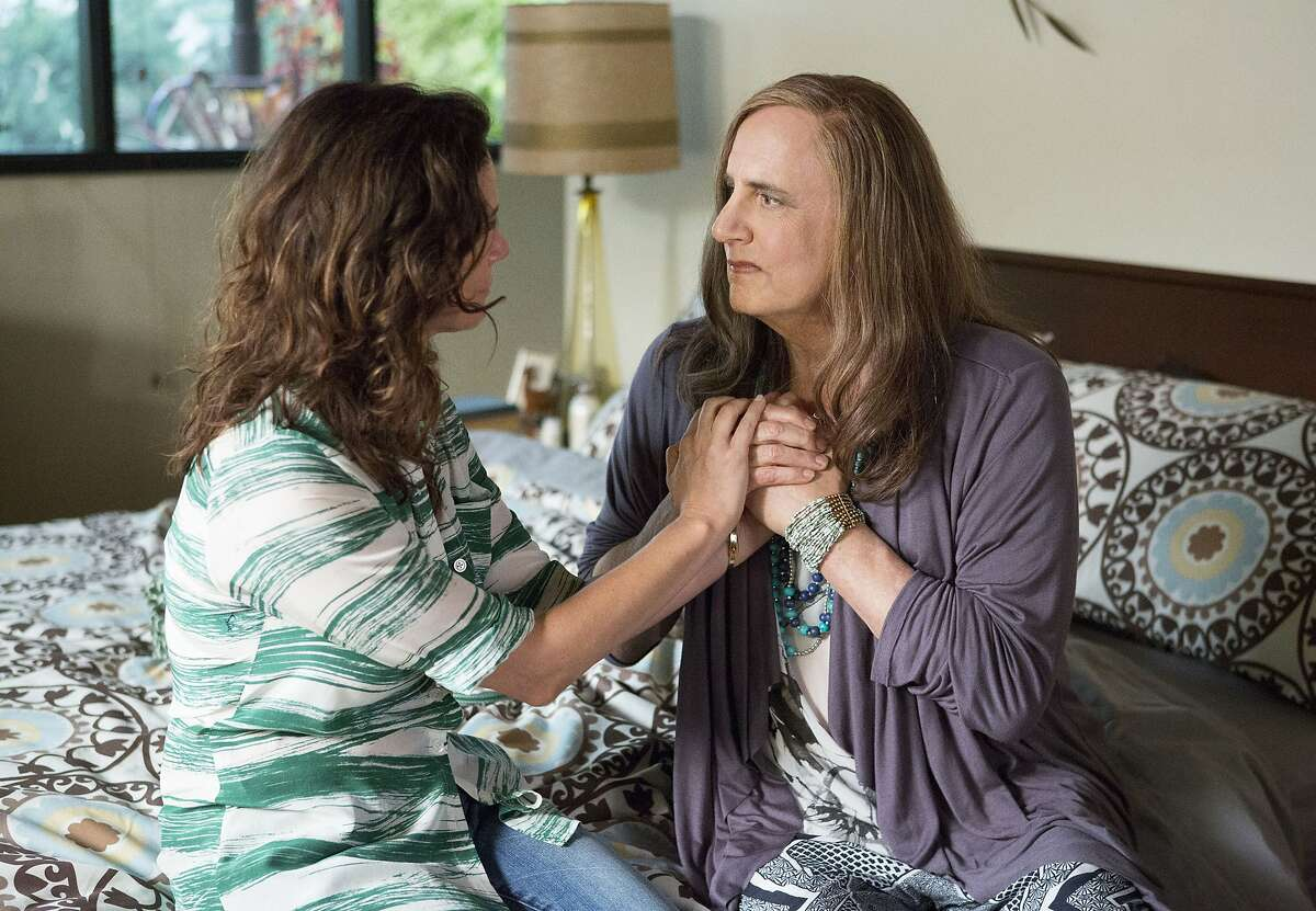 In this photo provided by Amazon Studios, Jeffrey Tambor, right, as Maura Pfefferman and Amy Landecker as Sarah Pfefferman appear in a scene from