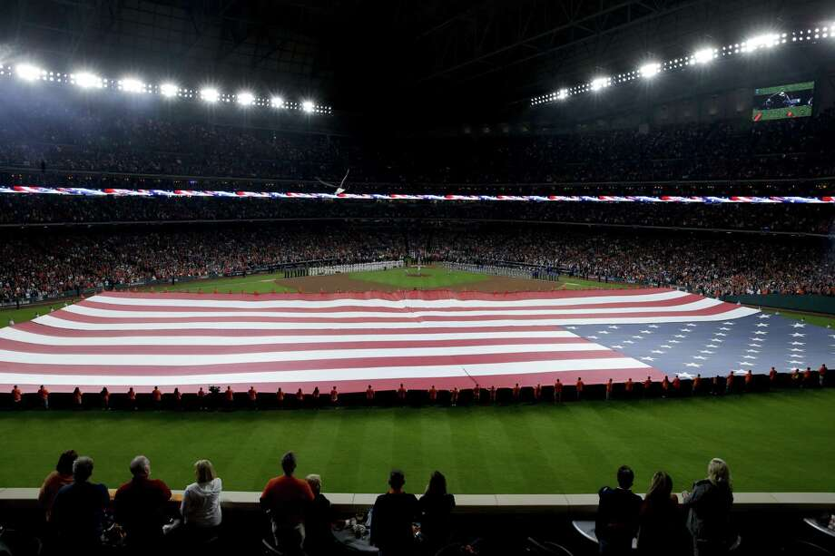 A reader is heartened by the patriotism that was on display during Game 3 of the World Series in Houston. Photo: Charlie Riedel /Associated Press / Copyright 2017 The Associated Press. All rights reserved.