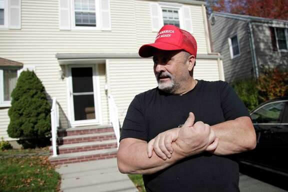Frank Roselli in his front yard in Bloomfield, N.J. on Friday. Roselli, a widower who retired two years ago, is thinking of moving to southern New Jersey, where he could potentially afford property taxes.