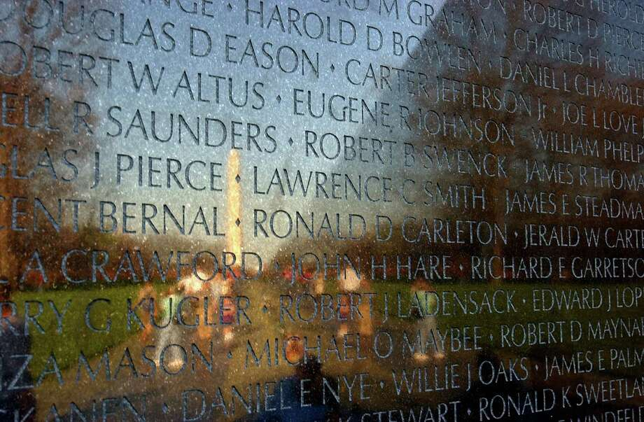 A reader reminds us that the Vietnam Veterans Memorial in Washington, D.C., includes, among its thousand of names, eight women who gave their lives for their country. Photo: Billy Calzada /San Antonio Express-News / SAN ANTONIO EXPRESS-NEWS
