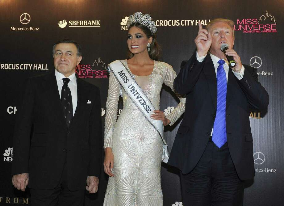 Among the many ties with Russian businessmen, there is this one for Trump. Russian businessman Aras Agalarov, left, helped Trump stage the Miss Universe 2013 in Moscow. He is shown here with Miss Universe Gabriela Isler, from Venezuela, center, and pageant owner Donald Trump. Photo: Irina Bujor /Associated Press / Kommersant.ru
