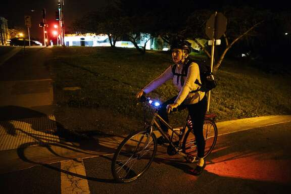 Sarah Prensky-Pomeranz pauses at intersection on her way to work at Raoul Wallenberg Traditional High School in San Francisco, Calif. Monday, October 30, 2017.