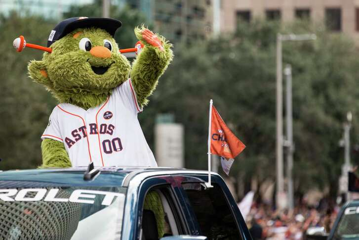 Houston Astros mascot Orbit waves to the crowd during the Astros World Series championship celebration parade on Friday, Nov. 3, 2017, in Houston.