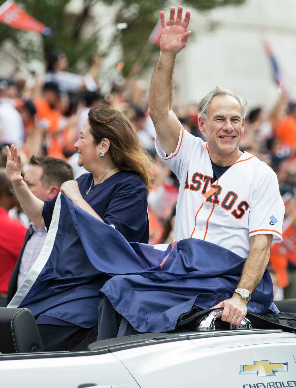 Gov. Greg Abbott waves to the crowd during the Astros World Series championship celebration parade on Friday, Nov. 3, 2017, in Houston.