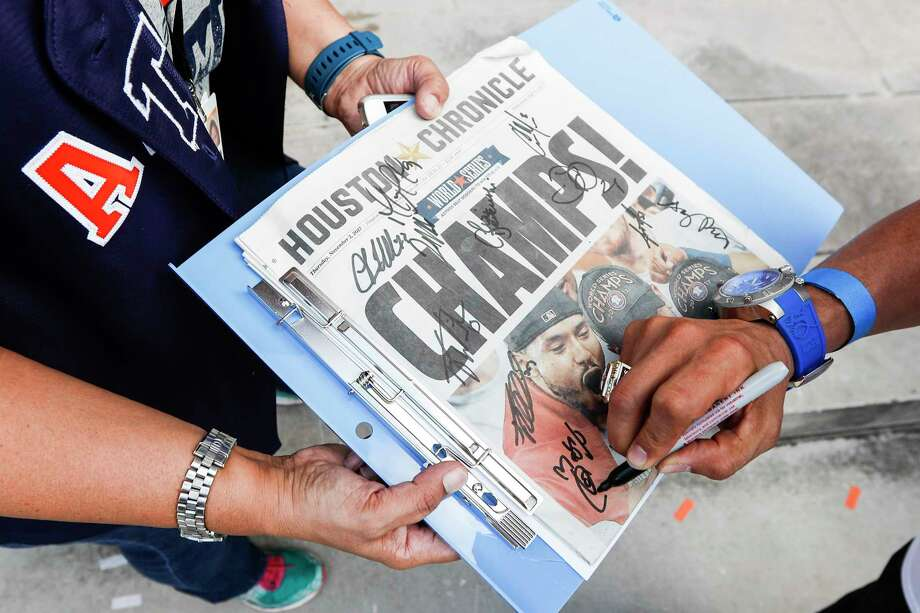 A Houston Astros fan as a Houston Chronicle autographed during the Astros World Series championship celebration parade on Friday, Nov. 3, 2017, in Houston. Photo: Brett Coomer, Houston Chronicle / © 2017 Houston Chronicle
