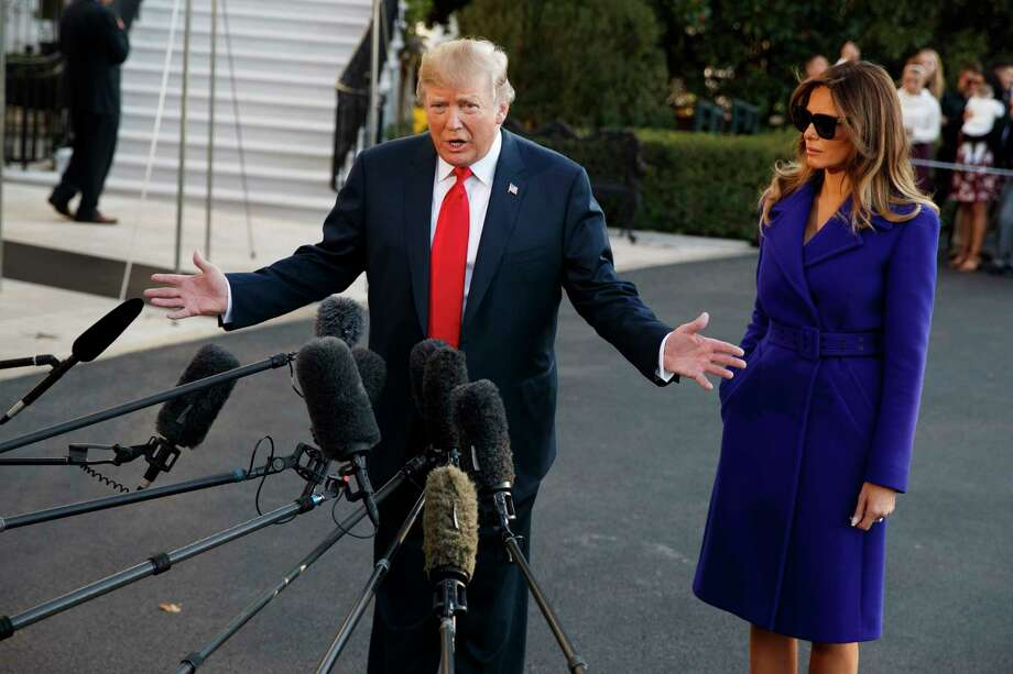 First lady Melania Trump looks on as President Donald Trump speaks with reporters before departing the White House for a trip to Asia, Friday, Nov. 3, 2017, in Washington. (AP Photo/Evan Vucci) Photo: Evan Vucci, STF / Copyright 2017 The Associated Press. All rights reserved.