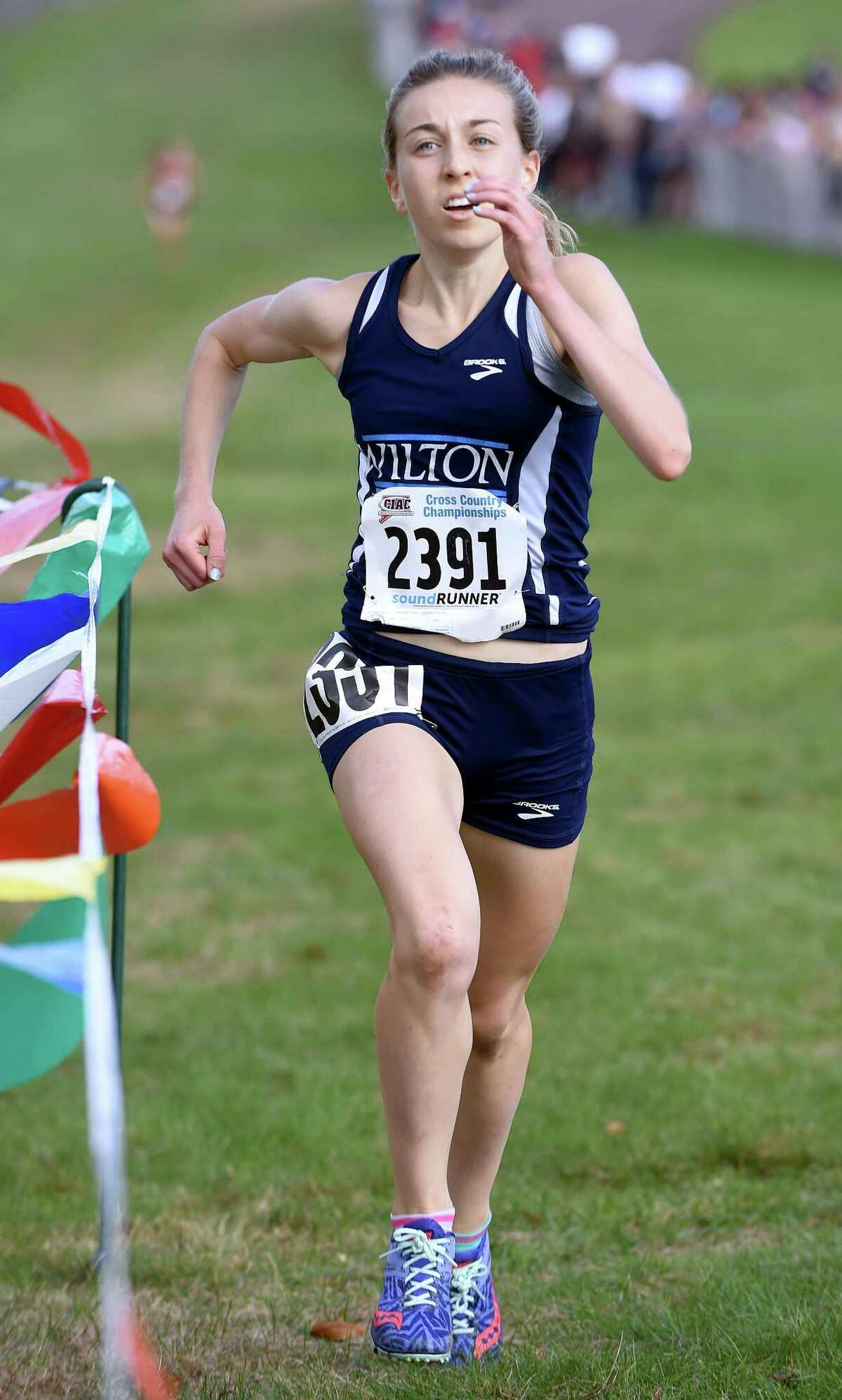 Morgan McCormick of Wilton nears the finish line placing first in the 2017 CIAC Fall Championship Girls Cross Country race in Manchester on November 3, 2017.