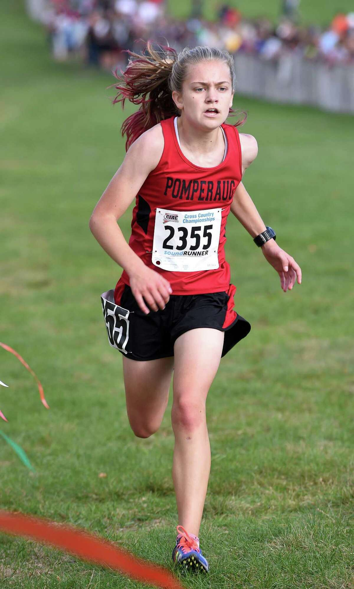 Katherine Wiser of Pomperaug nears the finish line placing second in the 2017 CIAC Fall Championship Girls Cross Country race in Manchester on November 3, 2017.