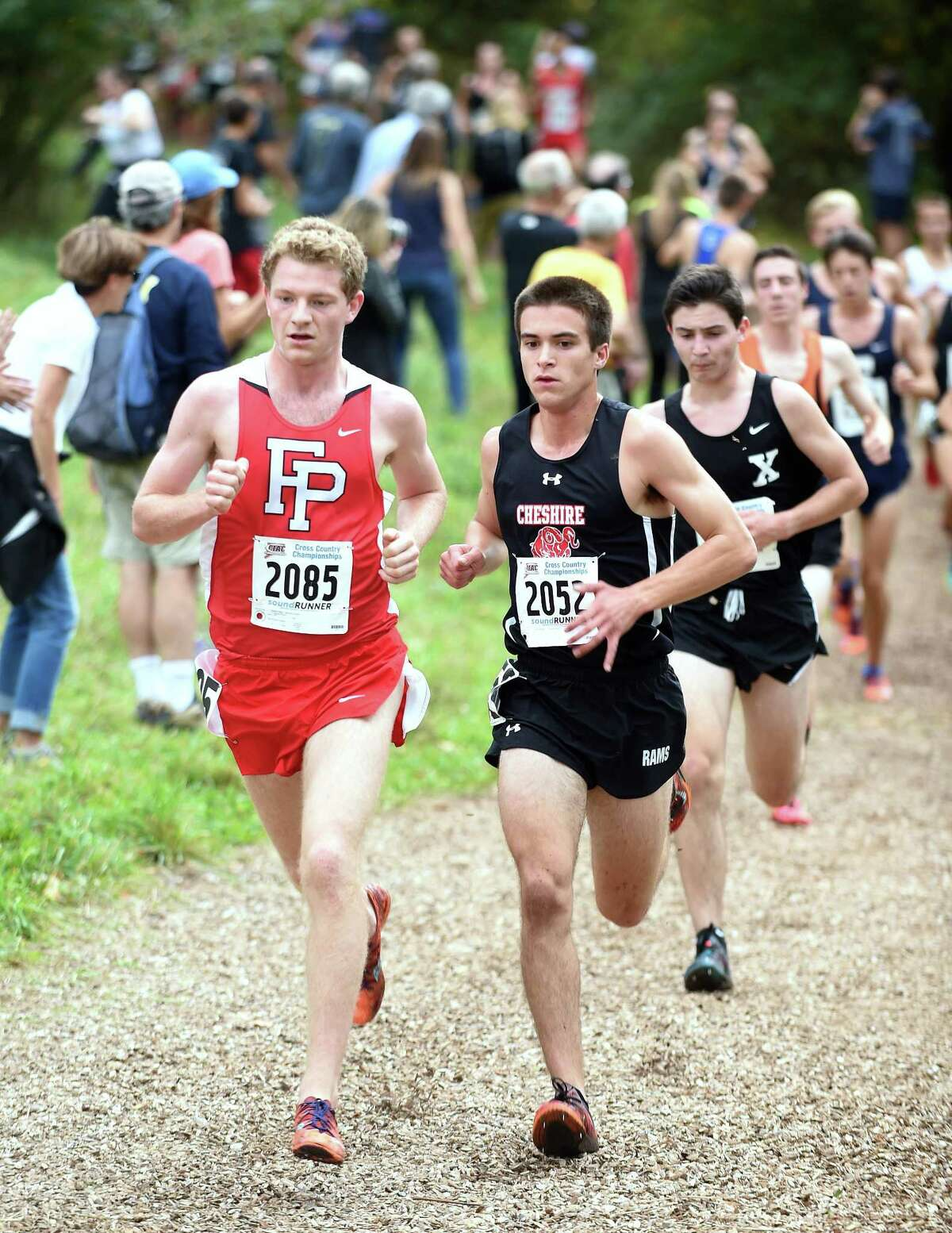 Drew Thompson (left) of Fairfield Prep and Brendan Murrary of Cheshire stay close during the 2017 CIAC Fall Championship Boys Cross Country race in Manchester on November 3, 2017.
