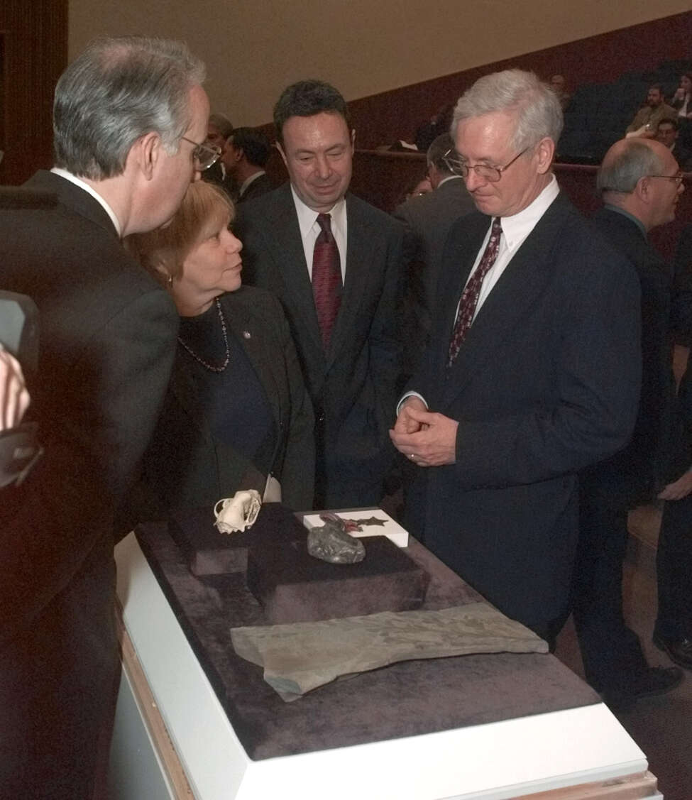 New York state Education Commissioner Richard Mills, right, shows fossils from the New York State Museum collection to legislators before a legislative hearing on the state budget Tuesday, Jan. 30, 2001 in Albany, N.Y. Assembly members are, from left: Steven Sanders, D-New York; Joan Millman, D-Brooklyn; and Ronald Canestrari, D-Albany.