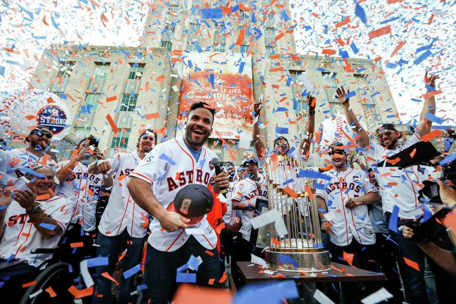 Houston Astros second baseman Jose Altuve tosses a World Series cap into the crowd during the Astros World Series championship celebration rally at City Hall on Friday, Nov. 3, 2017, in Houston. Photo: Brett Coomer, Houston Chronicle / © 2017 Houston Chronicle