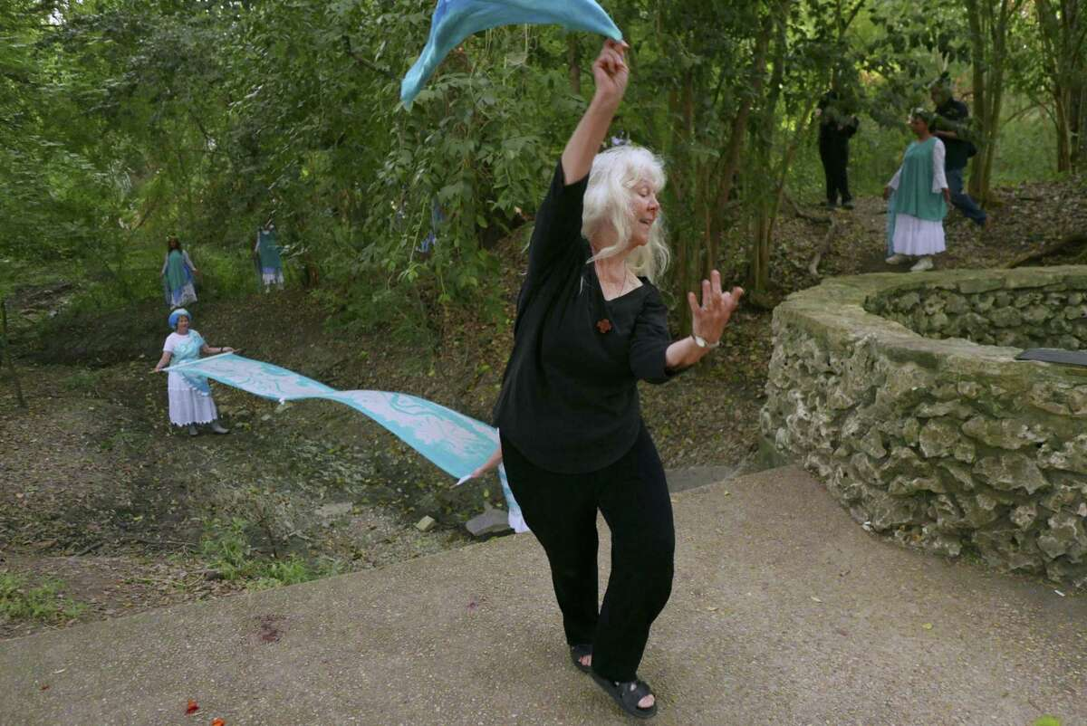 """Sister Martha Ann Kirk, chair of the Incarnate Word Sisters' Justice, Peace and Integrity of Creation Committee, performs a water dance by the Blue Hole headwater of the San Antonio River during an event entitled """"Standing with the Paris Climate Agreement, Celebrating Dancing with Creation"""" on June 24."""